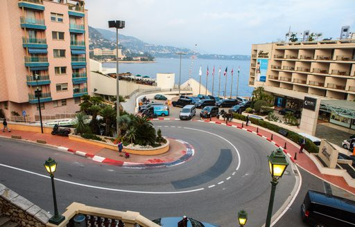 Tight, hairpin bend of the circuit of the Monaco Grand Prix, with the sea visible in the background