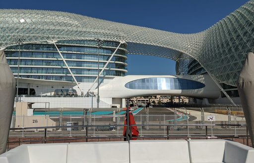 view of Abu Dhabi Grand Prix from the main deck aft of luxury superyacht on the qualifying day of the race