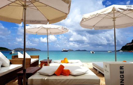 Sunloungers beneath parasols looking out at the ocean