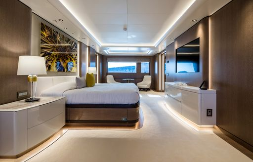 Large cabin on superyacht O'PARI with seats by window in background