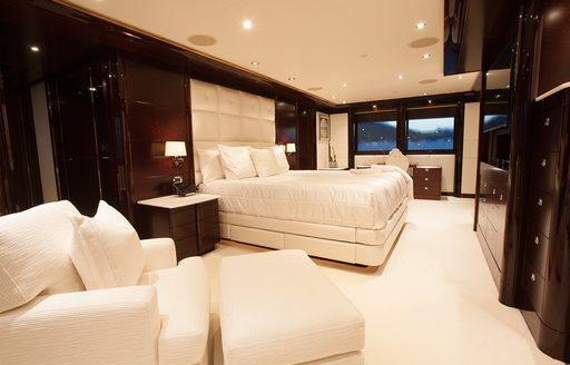 large bed and deep sofa in the master suite on board motor yacht TRENDING