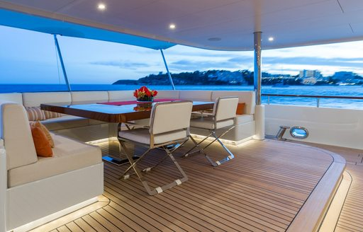 Motor yacht GO dining area on aft deck