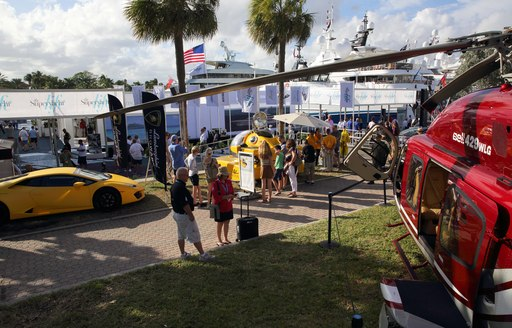 cars, helicopters and other exhibitors at the Fort Lauderdale International Boat Show