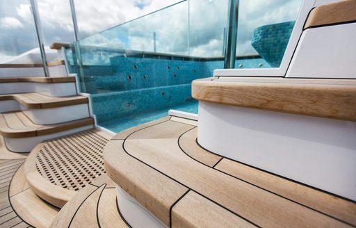 A detail shot of the teak decking on superyacht AQUILA