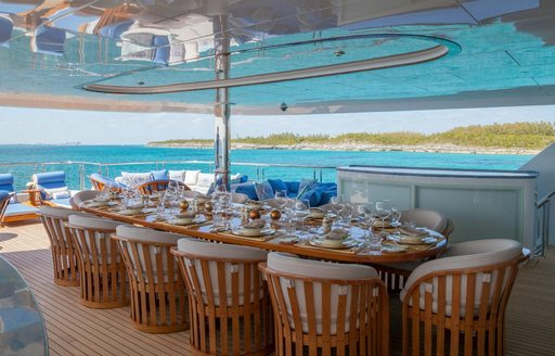 expansive alfresco dining area on the upper deck aft of charter yacht My Seanna