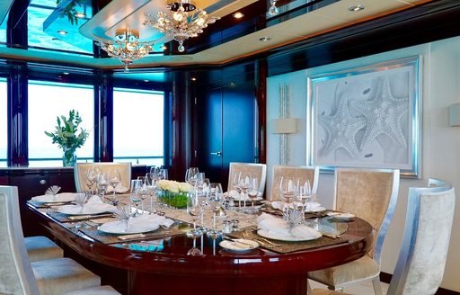 formal dining area in the main salon aboard charter yacht TRENDING