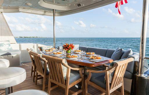 Al fresco dining on-board superyacht TEMPTATION