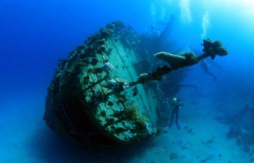 Scuba diver with shipwreck