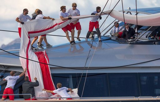 the crew at work on board charter yacht SEAHAWK during the Perini Navi Cup in Porto Cervo