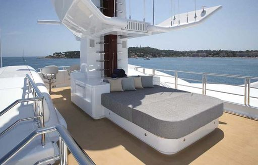 daybed on sundeck of luxury yacht wheels