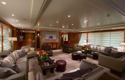 Main salon of charter yacht UTOPIA, with plenty of seating areas