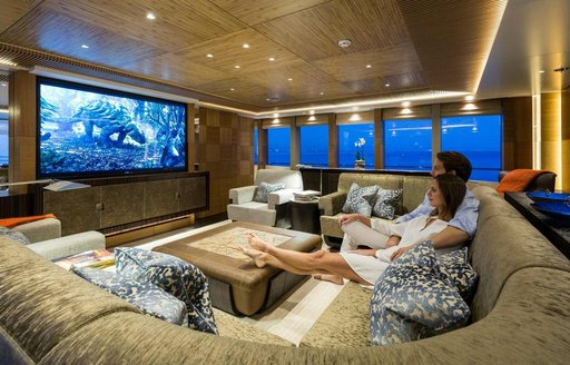 charter guests relax in movie lounge on board superyacht RUYA