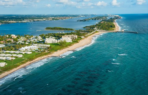 Aerial shot of Florida with blue sea and sandy beaches and condos on shore