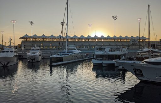 A fleet of motor yacht berthed at yas marina docks on the evening of the first day of Abu Dhabi Grand Prix 2019
