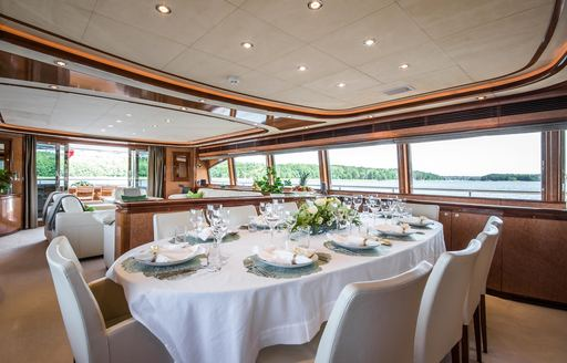 Fully laid dining table on Superyacht Queen of Sheba
