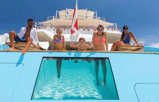 A family enjoys the swimming pool onboard MY Axioma