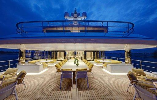 Superyacht Aquarius outdoor space nightime