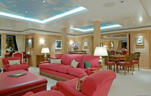 main salon with red sofas on board expedition yacht 'Northern Star'