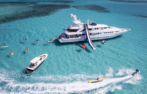 heesen yacht at last aerial view with slide and toys in the bahamas