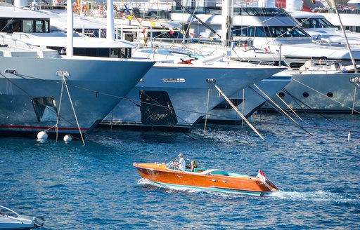 tender in the water at port hercules marina during monaco yacht show