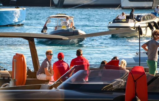 yacht crew on tender in port hercules marina