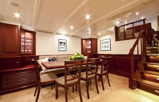 dining area in bright and airy main salon of charter yacht ANNAGINE