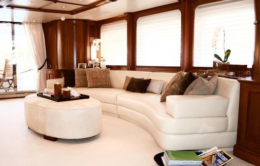 curved sofa in the main salon aboard charter yacht BRUNELLO