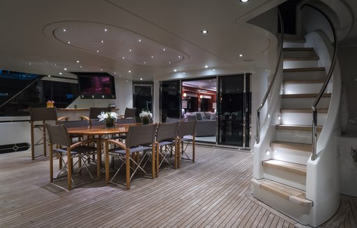 A dining table arranged on the exterior of a superyacht