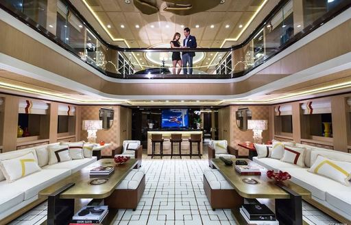 two-level atrium spanning across main deck and upper deck aboard superyacht AXIOMA