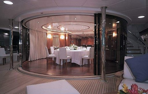 Benetti motor yacht MORE dining area leading onto deck