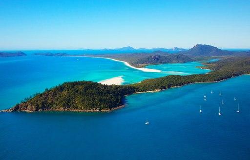 Idyllic Whitsunday Islands with blue seas and white sand, Australia