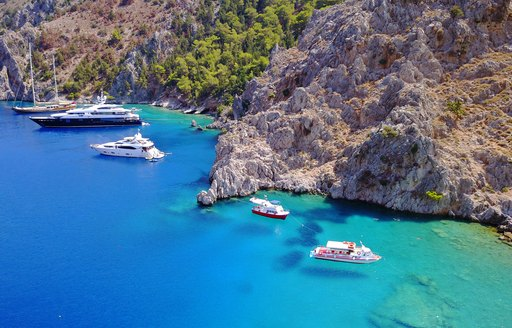 Yachts anchored in a sheltered cove in Greece