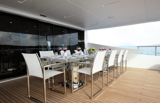 A dining table out on the exterior of luxury yacht WILLOW