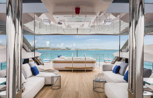 charter yacht vista blue sundeck with spa pool and sofas flanking the space