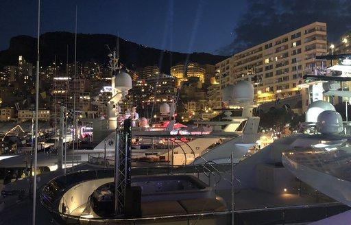 yachts at night at port hercules during monaco grand prix