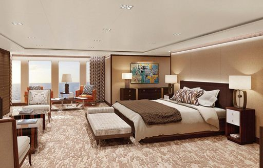 master suite with bed and full-length windows on board luxury yacht Planet Nine