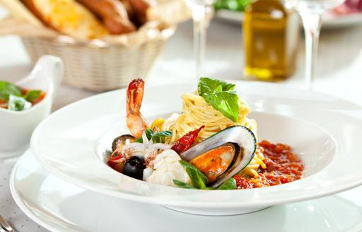Fresh pasta and shellfish on dining table, classic Italian cuisine