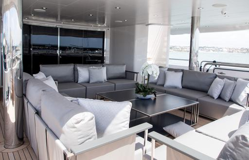 sumptuous outdoor lounge on the main deck aft of superyacht 'Princess AVK'