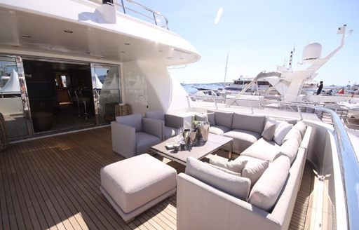 Comfortable seating area on deck of explorer yacht SEAL