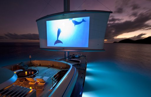 alfresco cinema setup on deck of luxury yacht Maltese Falcon at night