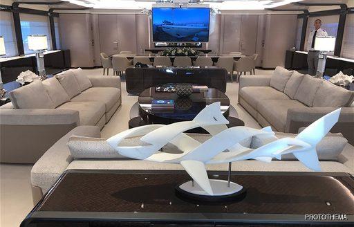 o'pari superyacht main salon with statue and sofas
