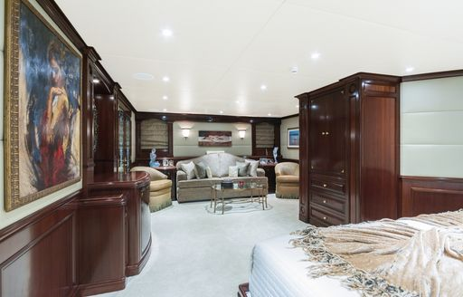 large master suite with lounge area on board superyacht STARSHIP