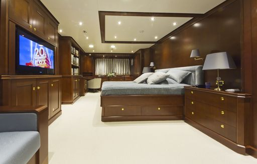 bed and tv in master suite of luxury yacht Axantha II