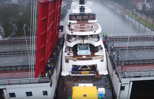 Aft decks of luxury yacht Lady S as she passes between bridge