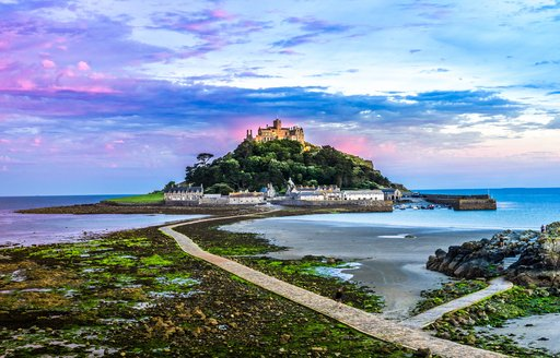 castle on the hill in cornwall, st michaels mount at low tide with sunset