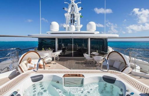 The Jacuzzi and sun lounging options available on the exterior of superyacht Grace E