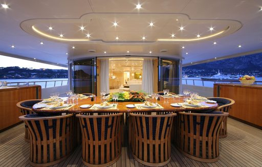 dining table is prepared for an alfresco dinner abroad luxury yacht CAPRI