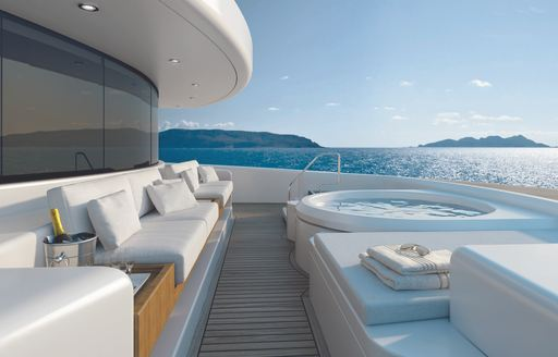 seating, Jacuzzi and sun pads on the foredeck of luxury yacht SOLO