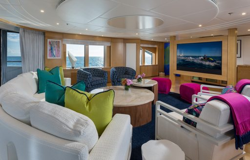 Skylounge on Superyacht BACA with comfortable seating and large TV screen