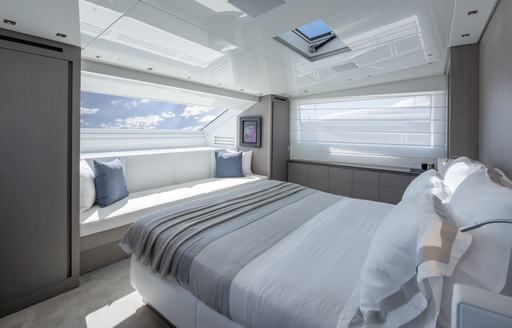 large bed in the master suite on board motor yacht DINAIA